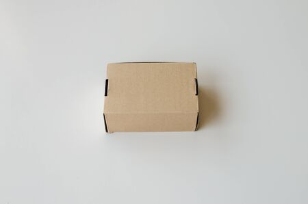 Brown cardboard box on white background.