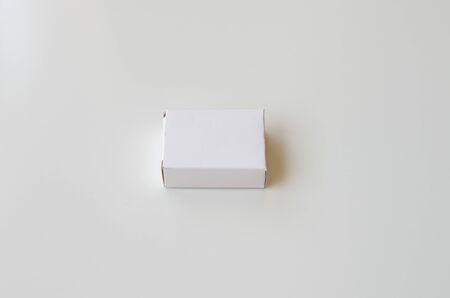 White cardboard box on white background. Side view
