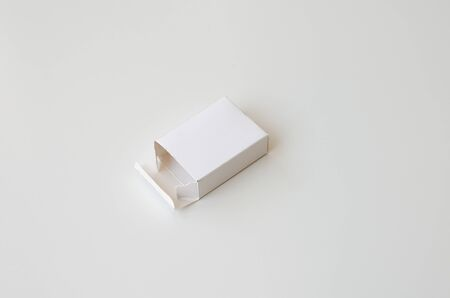 Open white cardboard on white background. Perspective view