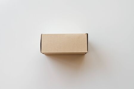 Brown cardboard box on white background. Side view 写真素材
