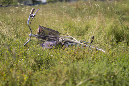 road bike: bike lies in the field