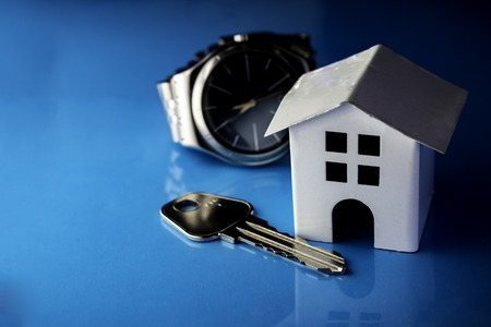 Mortgage concept by house. White house on a blue background