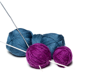 Purple and blue yarn on a white background