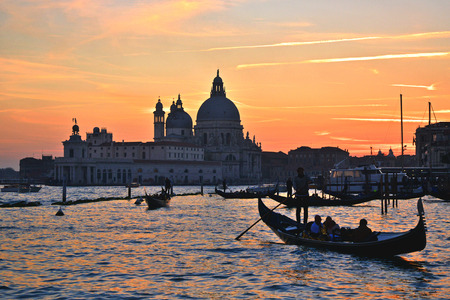 gondolier: Gondolier in Venice at sunset Stock Photo