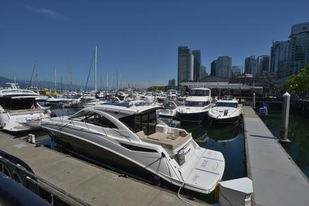boat docked alonside marina Stock Photo