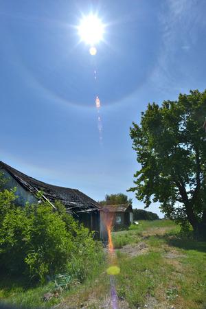 sun dog over old shack