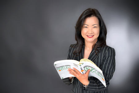 asian teacher holding book Stock Photo