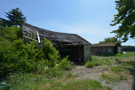 old garage that is about to fall down