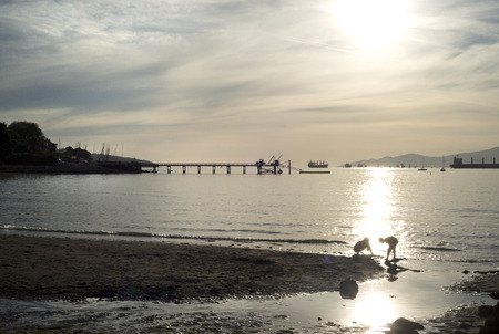 pier at sunset kits beach vancouver 2 Stock Photo