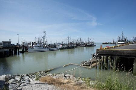 boate line a pier at Steveston, Canada Editorial