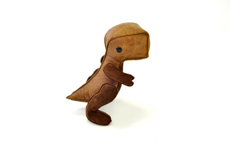a cute custom handcrafted stuffed leather toy baby dinosaur Stock Photo