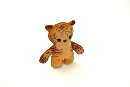 a cute custom handcrafted stuffed leather toy kitty