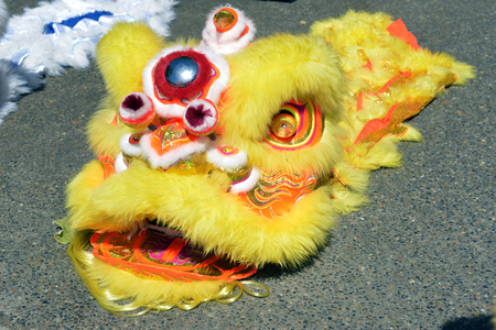 yellow chinese lion dance head on ground