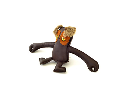 freak: a cute custom handcrafted stuffed leather toy long armed freak Stock Photo