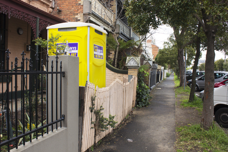Melbourne, VictoriaAustralia- August 31 2016: A portable toiletdunny in the front yard of a surban house in Melbourne, Australia.