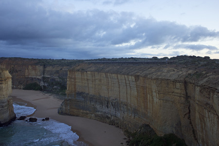 Port Campbell, VictoriaAustralia- September 3 2016: A cliff edge at Twelve Apostles showing the tourist access track that leads along the cliff to the lookout. Port Campell National Park in Victoria, Australia. Editorial