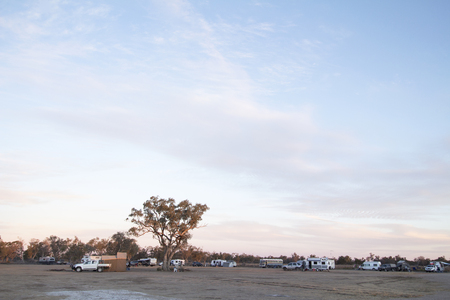 Caravans and campers at the Pilliga Bore Bath campground in New South Wales, Australia. A popular low-cost campground with the addeded benefit of an artesian bore supplied swimming pool the stays constantly warm and is rich in minerals that are said to gi Editorial
