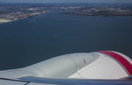 View from the window of a commercial airliner as it banks and approaches landing in Brisbane, Australia.