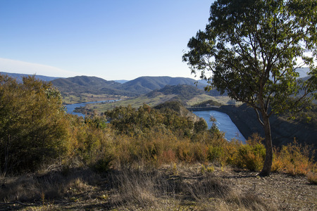 View from a lookout above tumut 3 Power Station. The top of the power station can be seen on the right of the photograph and the Tumut River on the left.