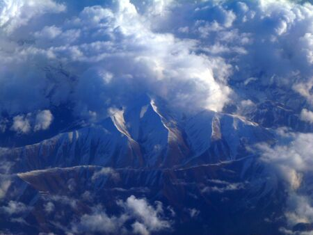 arial: Arial View of mountains, Snow and Cloud