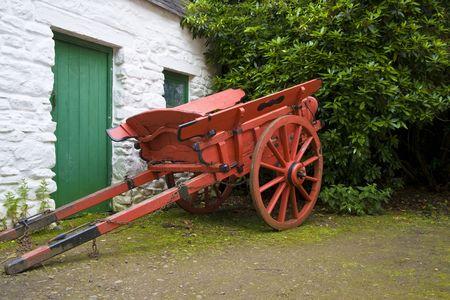 whitewashed: Old horse drawn cart beside whitewashed outbuilding
