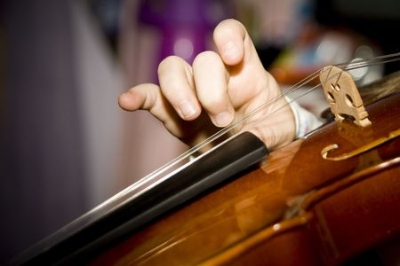 plucked: Close up of a violin string being plucked