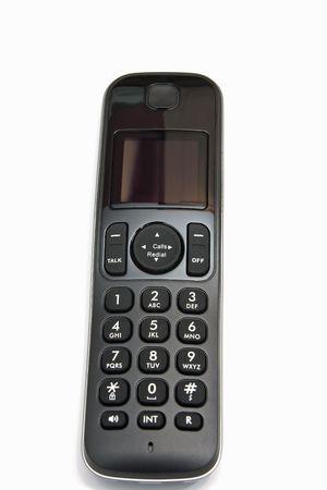 teclado num�rico: tel�fono m�vil con teclado num�rico sobre fondo blanco