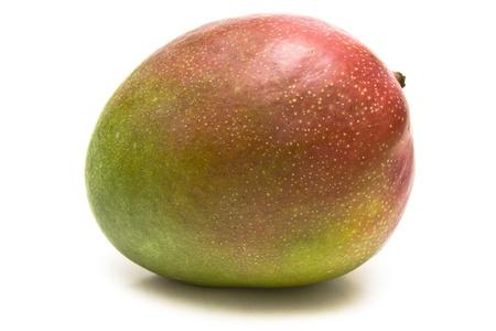 Ripe mango over a white background Stock Photo