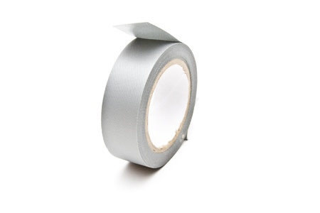 Roll of grey tape over a white background