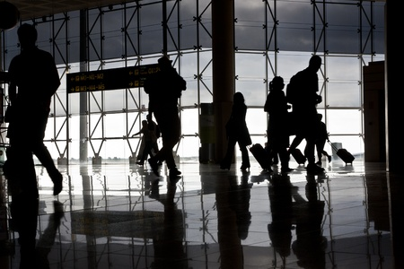 Silhouette of airport travellers Editorial