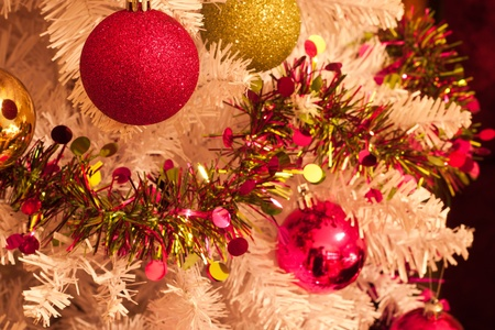 Colourful Christmas decorations hanging on a tree Stock Photo