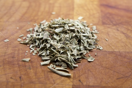 A pile of dried Tarragon on a wooden bench Stock Photo