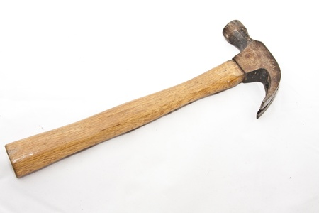 A rusty claw hammer over a white background