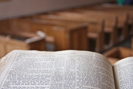 A bible in a church pulpit overlooking the church Stock Photo