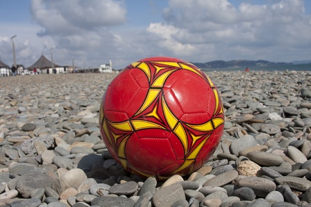 A football on a stony beach Stock Photo