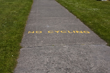 A no cycling notice painted on a footpath