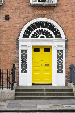 A yellow Georgian style door in Dublin Ireland photo