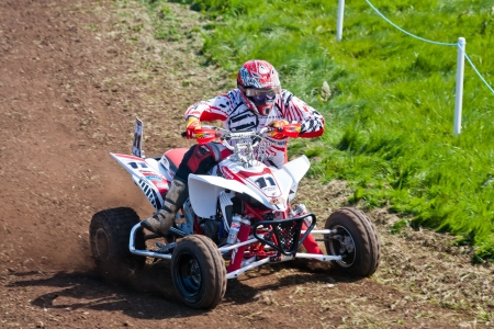 A quad bike racer in action.