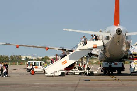 disembark: Passengers disembark Easyjet Airbus 319, Barcelona, Spain Editorial