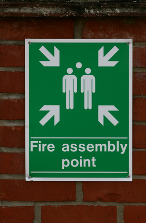 essex: Fire assembly point sign, Braintree, Essex, England Stock Photo