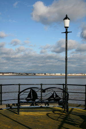 Metal bench facing seafront from the end of Southend Pier, Southend on Sea, Essex, England photo