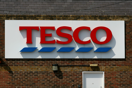 Tesco store logo attached to brick wall, Grove Shopping Centre, Witham, Essex, England