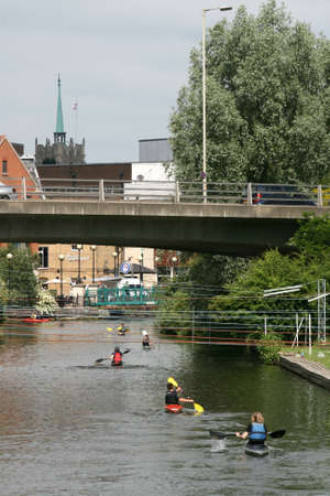 canoeist: Canoeists on River Chelmer nearing city centre of Chelmsford, Essex, England