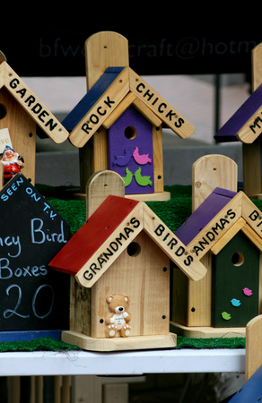 the novelty: Novelty bird boxes for sale, High Street market stall, Chelmsford, Essex, England Stock Photo