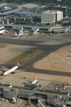 west sussex: LONDON - AUG 6, 2014 View from departing aircraft of terminal buildings and taxiways, Gatwick Airport, West Sussex, England