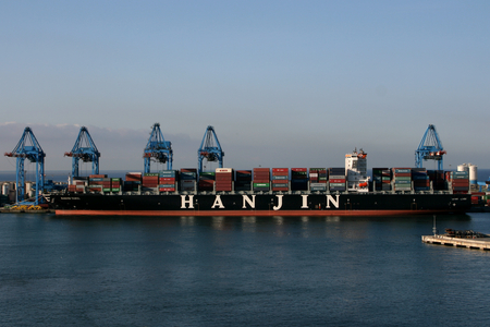 GENOA, ITALY  -  AUGUST 6, 2014 - Container ship Hanjin Tabul in Genoa Port, Italy