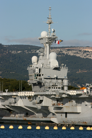 toulon: R91 Charles de Gaulle is an aircraft carrier of the French Navy seen here docked in the naval port at Toulon, France