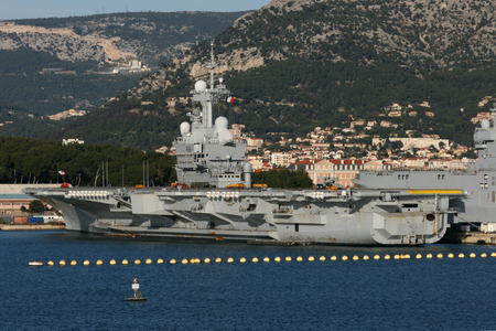 gaulle: R91 Charles de Gaulle is an aircraft carrier of the French Navy seen here docked in the naval port at Toulon, France