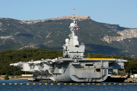 R91 Charles de Gaulle is an aircraft carrier of the French Navy seen here docked in the naval port at Toulon, France