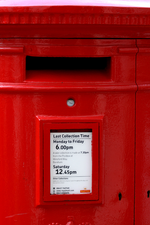 royal mail: Red Royal Mail post box with collection time details in High Street, Chelmsford, Essex, England